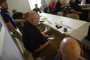Image of Law Enforcement inspecting training samples of industrial hemp
