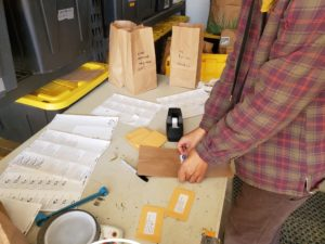 labels being added to paper bags